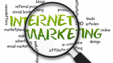 Magnified illustration with the word Internet Marketing on white background.