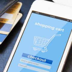 mobile shopping concept - virtual shop on phone screen with credit cards